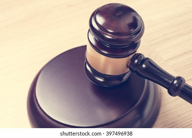 Justice hammer or judge gavel made from wooden on table, vintage theme background