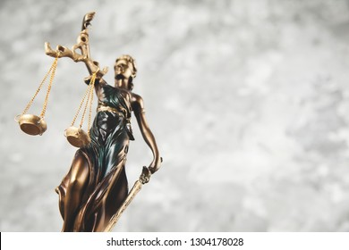 justice lady on the gray wall background