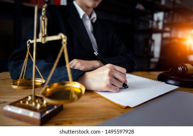 Justice and law concept. Lawyer businesswoman working on table office.