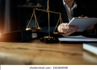 Justice and law concept. Lawyer businesswoman working with tablet and laptop on table office. Law interface icon.