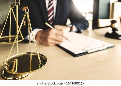 Justice and Law concept. lawyer working on paper documents at courtroom