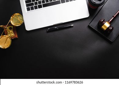 Justice and law concept.Lawyer workplace with laptop and documents with black dark  top view