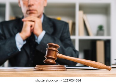 justice and law concept.Male judge in a courtroom working on wood table with documents., attorney court judge justice gavel legal legislation concept