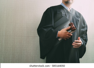 justice and law concept.Male judge in a courtroom with the gavel and holy book and digital tablet computer