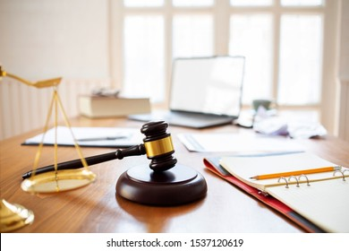 Justice law Scales and books and wooden gavel tool on desk in  Lawyer office.concept