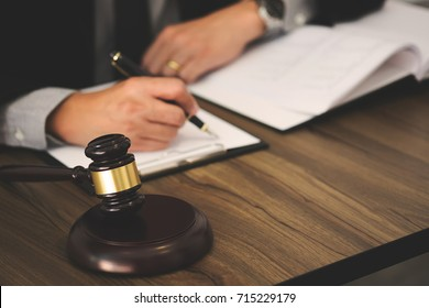 justice lawyer / judge gavel working with legal documents in a court room