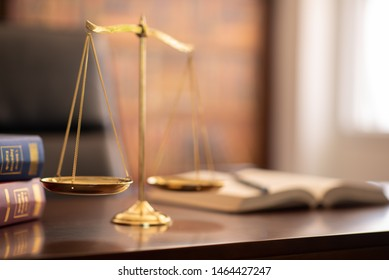 justice legal and jurisprudence concept.scales of justice and law books on lawyer desk at law firm.