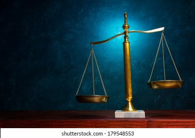Justice scale with blue highlight in the background