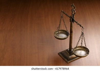 Justice Scale on wood table