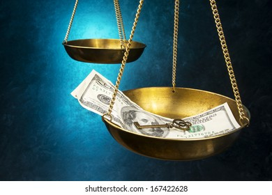 Justice scales with money and key