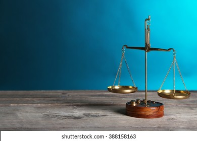Justice scales on blue background
