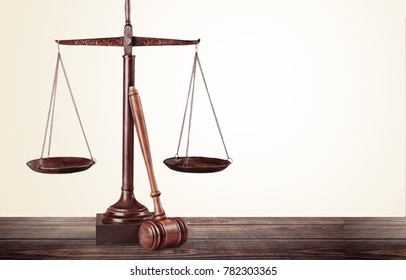 Justice Scales on wooden