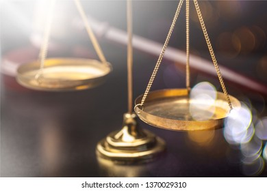 Justice Scales and wooden gavel on wooden table