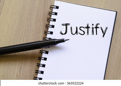 Justify text concept write on notebook with pen