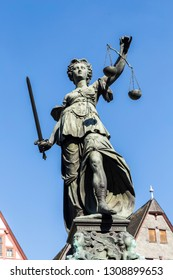 Justitia (Lady Justice) sculpture on the Roemerberg square in Frankfurt, built 1887.