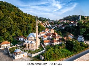 Jusuf Pasha Kursumlija mosque and old town of Maglaj in Bosnia and Herzegovina. Aerial view. Toned image.