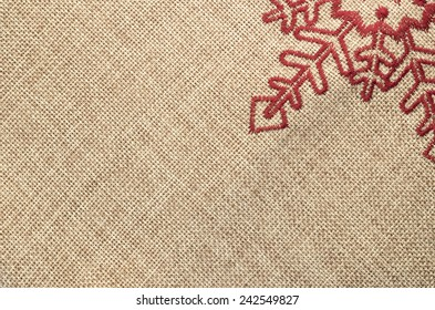 juta fabric decorated with red sewed star