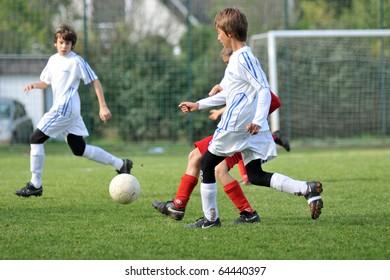 JUTA, HUNGARY - OCTOBER 9: Unidentified players in action at the Hungarian National Championship under 13 game between Mezga FC and Szentlorinc October 9, 2010 in Juta, Hungary.