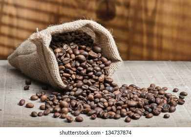 jute bag with coffee beans on wooden table