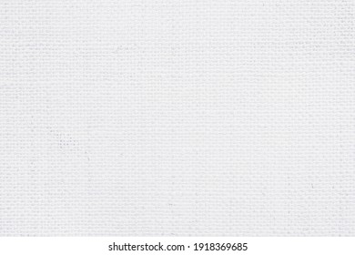 Jute hessian sackcloth canvas woven texture pattern background in light white color blank empty.