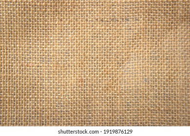 Jute hessian sackcloth canvas woven texture pattern background in light beige cream brown color blank empty
