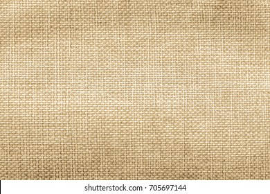 Jute hessian sackcloth natural burlap texture background in yellow gold brown color