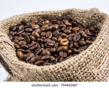 jute sack with roasted coffee beans isolated on white background