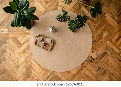 Jute Twine round Mat rug eco style with green plant. Knitted at home decoration concept. round brown natural linen bed mat near green potted plants