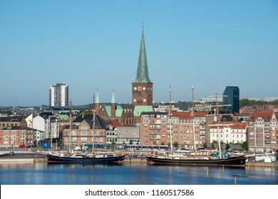 Jutlandia, Denmark - august 9, 2018: Sailboats buildings and towers of St. Clements Cathedral on the waterfront of Aarhus harbor