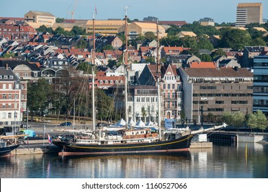 Jutlandia, Denmark - august 9, 2018: Sailboat moored in the docks of the city of Aarhus and view of the first line of buildings of the maritime avenue