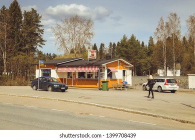 Juvaskyla, Finland - may 2019: a small town in Finland, a roadside cafe, cars on the road and shops. Summer day of the Finnish town. coffee Jaffa.