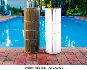 Juxtaposition of a dirty reusable washable pleated reinforced polyester cartridge pool filter next to a clean filter, after routine maintenance cleaning. Pool surrounded by bricks in background.