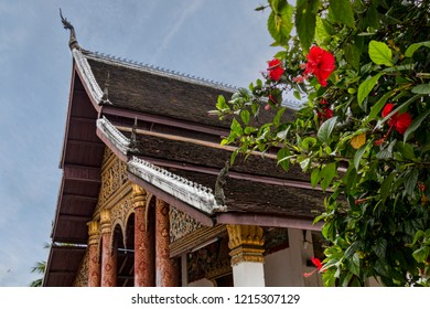 Juxtaposition of Flowers and Buddhist Temple (Luang Prabang, Laos).