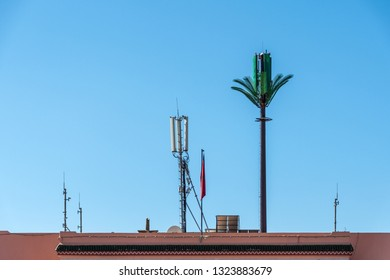 Juxtaposition of modern communication infrastructure on ancient old walls in Marrakesh, Morroco.