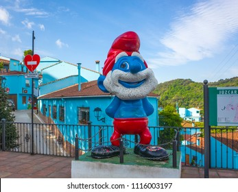 JUZCAR, SPAIN: MAY, 2018: Juzcar in uplands of Andalucia. Chosen to be the set of the Smurf movie, the small village has kept the blue paint look and murals to attract tourists.