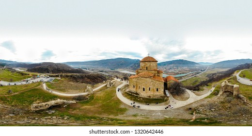 Jvari Monastery Drone Panorama with tourists and visitors during a cloudy day in Mtskheta, Georgia