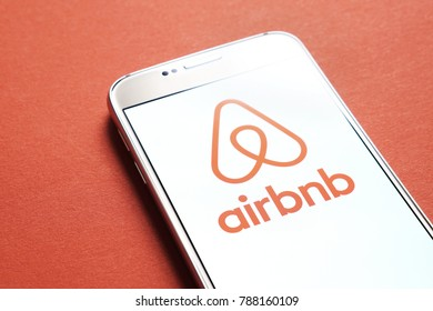 JYVASKYLA, FINLAND - JANUARY 4, 2018: Airbnb logo on smartphone screen. Airbnb is an online marketplace offering people a service to rent short-term lodging. Illustrative editorial.