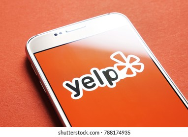 JYVASKYLA, FINLAND - JANUARY 4, 2018: Yelp logo on smartphone screen. Yelp is a website that publish crowd-sourced customer reviews and ratings for local businesses. Illustrative editorial.