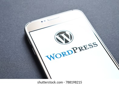 JYVASKYLA, FINLAND - JANUARY 4, 2018: WordPress logo on smartphone screen. WordPress is an open source content management system to edit, publish and host websites. Illustrative editorial.