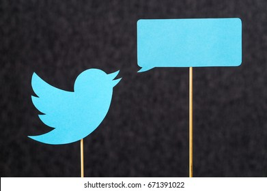 JYVASKYLA, FINLAND - JULY 2, 2017: Twitter logo and speech balloon cut from cardboard against dark background. Twitter is a social media network that was founded in 2006. Illustrative editorial.