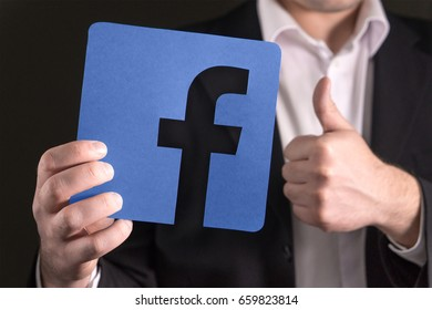 JYVASKYLA, FINLAND - JUNE 13, 2017: Man in a suit giving thumbs up with a cardboard Facebook logo. Facebook is a popular social media platform launched in 2004. Illustrative editorial.