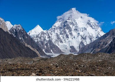K2 mountain peak with cloud on top, Baltoro glacier, Gilgit, Pakistan, Asia