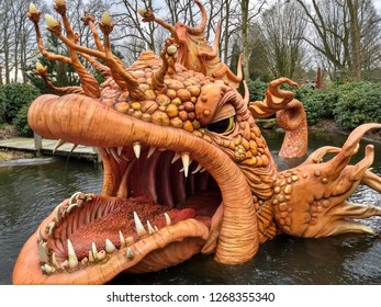 Kaatsheuvel / The Netherlands - March 29 2018: Theme Park Efteling. Big orange fish from the fairytale Pinocchio opens its eyes and mouth, spits fountains and shows pinocchio in the mouth.