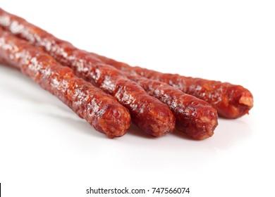 Kabanos. Polish long thin dry sausage made of pork. Isolated on white background.