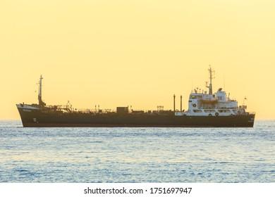 "Kabardinka, Krasnodar Krai, Russia - May 19 2020: Oil Products Tanker ""Bellona"" at sunset"