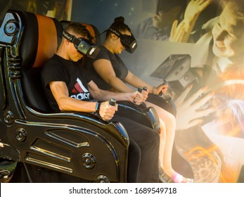 Kabardinka, Russia - August 8, 2019: Park attraction of virtual reality in the process of a dynamic racing game