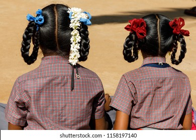 Kabini, Southern India, 3/9/2017, School girls in uniform with hair meticulously done in braids and flowers and bows