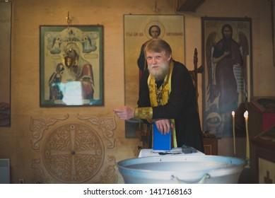 Kablukovo Village, Russia - September 1, 2018. Orthodox priest reads a sermon, a prayer.