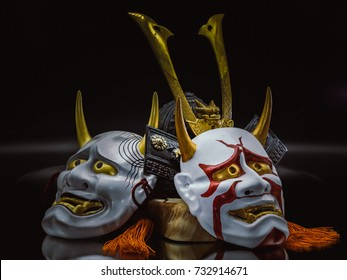 Kabuki Mask and Bushido Legend concept. Bushido Warrior Iron Hat and Kabuki Masks closeup on background.