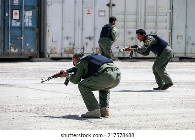 KABUL, AFGHANISTAN - 31 MARCH 2013:  Unidentified body guards practice contact drills at a Private Security Company base on.  Kabul continues to suffer ongoing violence, with regular suicide attacks.